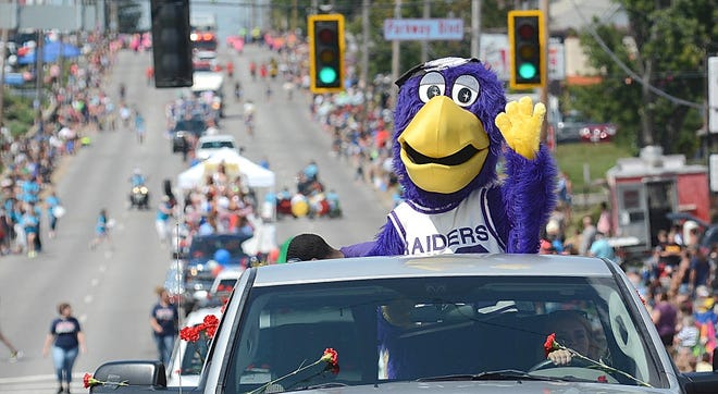 MUcaw, the mascot of the University of Mount Union, waves to the crowd during the 2017 Greater Alliance Carnation Festival Grand Parade.