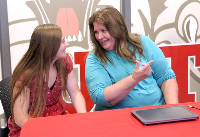 Canton South High School teacher Nancy Q. Miller, right, speaks with Marah Mayle, the student who nominated her for state Teacher of the Year, on Monday after the state's virtual ceremony recognizing this year's regional winners. Miller was named the State Board Teacher of the Year for District 8. She watched the state's announcement Monday at Canton South High School.