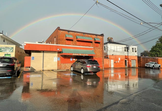 John's Bar in Canton was shrouded by a rainbow July 12 after a storm that traveled through the area.