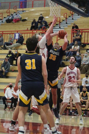 Mooresville senior Luke Fowler (35) battles for two points over Martinsville senior Zach Lynn at Friday's Mid-State Conference game at Martinsville.