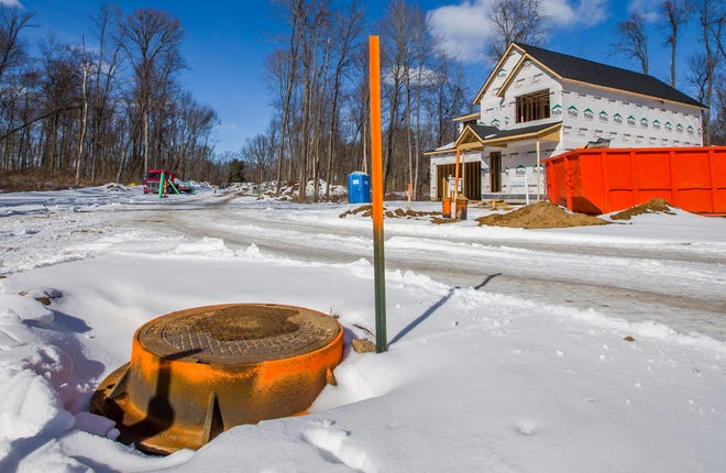 The Hills, a new subdivision in Granger, under construction on Wednesday, Feb. 3, 2021. The developer built sewer lines in the neighborhood to avoid the use of septic tanks.