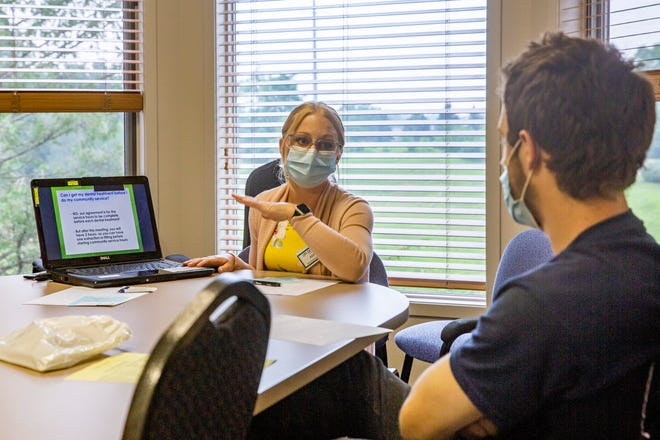 Ashley Kosowski, patient coordinator for Dr. Angie's Dental Health Exchange, helps to enroll patient Douglas Lodholtz on  July 23.