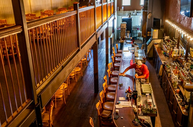 Owner Dominick Simeri  cleans inside Madison Oyster Bar on Monday in South Bend. The bar will reopen this week after more than 500 days of being closed due to the COVID-19 pandemic.