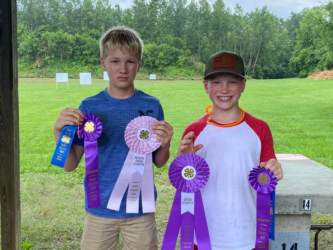 Winners of the 2021 rifle shoot included reserve grand champion Carter Sollars, left, and grand champion William Ranard, right.