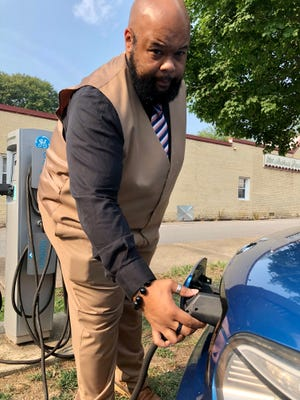 Jamaal Edwards uses the uptown charging station to recharge his 2015 Kia Soul EV.