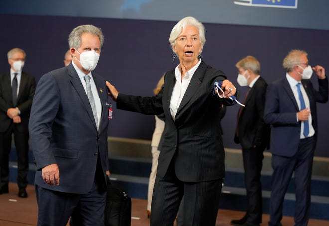 European Central Bank President Christine Lagarde, right, poses with David Lipton, senior adviser to U.S. Treasury Secretary Janet Yellen, during a group photo of Eurogroup finance ministers at the European Council building in Brussels on July 12. Lagarde has hinted that the bank will provide monetary support primarily because of the risk the pandemic could pose to the euro zone's economic recovery.