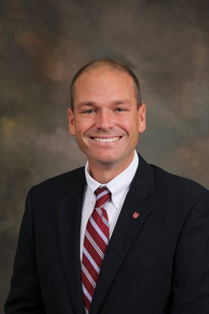 Jack Holland has been named Benedictine's athletic director.