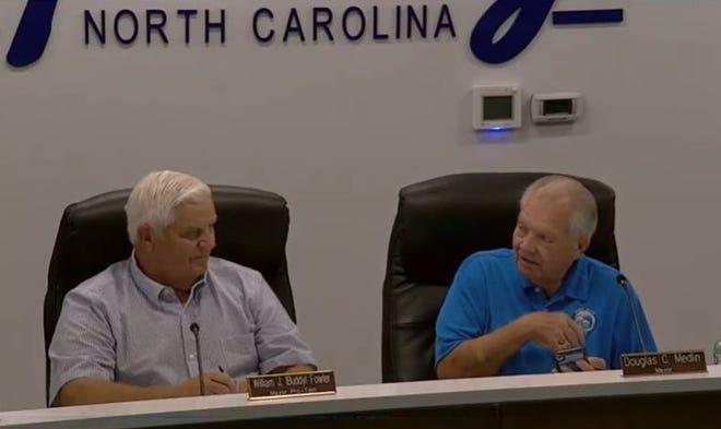 Mayor Pro-Tem William J. Fowler and Mayor Douglas C. Medlin discuss noise issues.