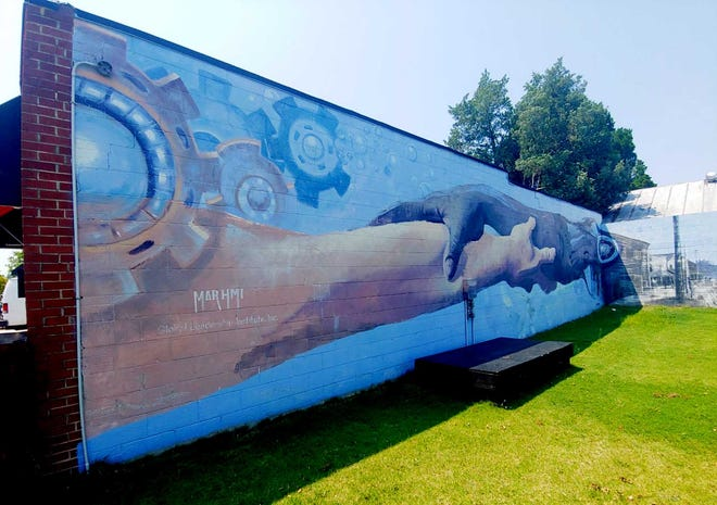 This is part of three murals in the Five Points business district, signifying unity and New Bern history.