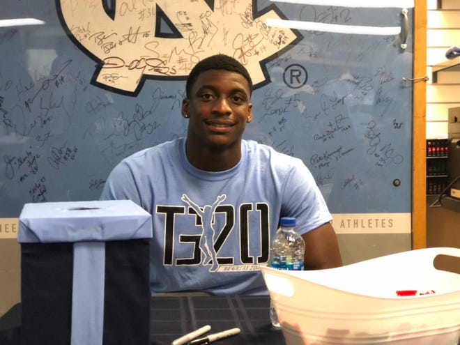 UNC sophomore cornerback Tony Grimes took advantage of the NCAA's new name, image and likeness rules when he met with around 200 Tar Heel fans over three hours at Chapel Hill Sportswear on Franklin Street. Grimes signed autographs and sold some of his very first TG20 T-shirts, which the store printed free of charge.