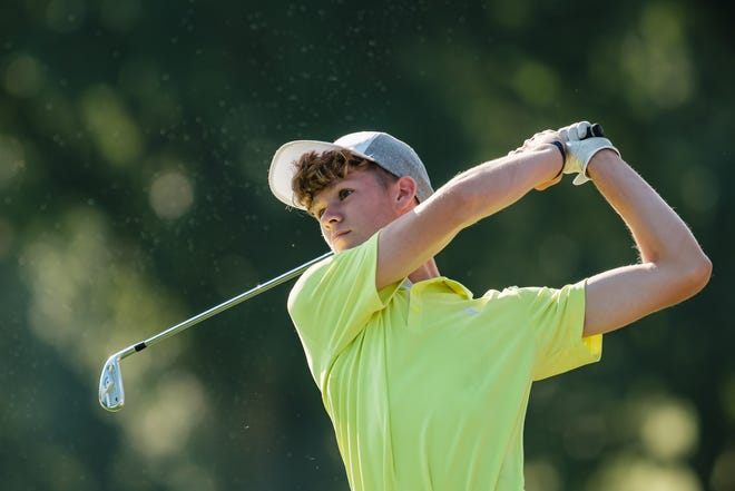 New Philadelphia's Shad Kenily helped the Quakers win the East Central Ohio League title. Kenily tees off during the First National Bank Junior Tour Tournament of Champions at Union Country Club back in July.