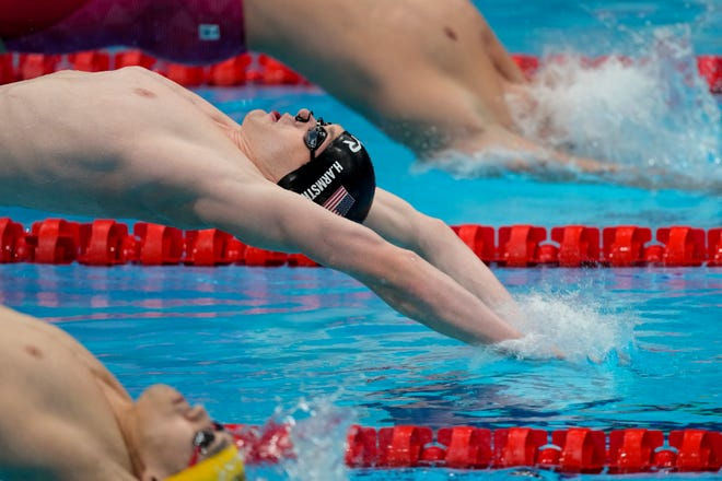 Hunter Armstrong swims in a heat during the men's 100-meter backstroke at the 2020 Summer Olympics, Sunday, July 25, 2021, in Tokyo, Japan.