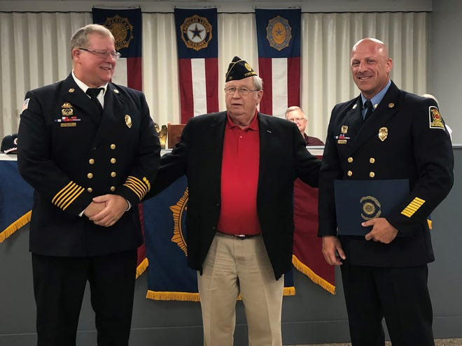 American Legion Post 31 recently presented Capt. Ben Noel, right, of the Fort Smith Fire Department, an appreciation award for his community service. Noel is a 21-year veteran of the fire department and has been awarded several recognition awards, including the Medal of Valor. Fire Chief Phil Christensen, left, is seen looking on as post member Keith Greene presents the award.