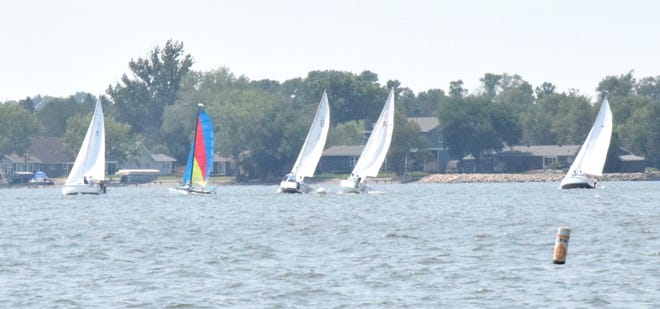 Sailboat racing is a physically demanding sport that requires practice and experience with your water vessel.