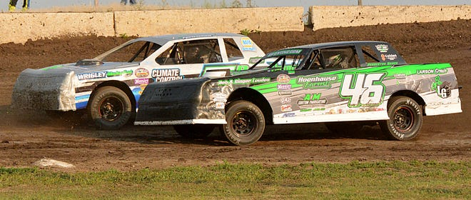 Jonny Carter of Lisbon, N.D. (46) and Ryan Pommerer of Oriska, N.D. battle for position during a street stock heat race during the Steffes Street Stock Tour Special at Casino Speedway. Carter, the defending tour champion, late won the $1,000 prize for taking the 25-lap feature.