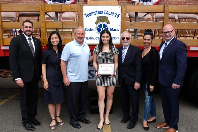Angelina Bairos and family with Teamsters Local 25 Business Agent Jason Lopes, Boston City Councilor Michelle Wu and Teamsters Local 25 President Sean O'Brien.