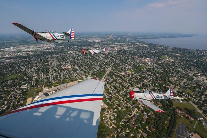The Geico Skytypers air show team do a media fly along routine Monday, July 26, 2021 over Winnebago and Fond du Lac Counties as they prepare to perform for the Air Venture air shows.