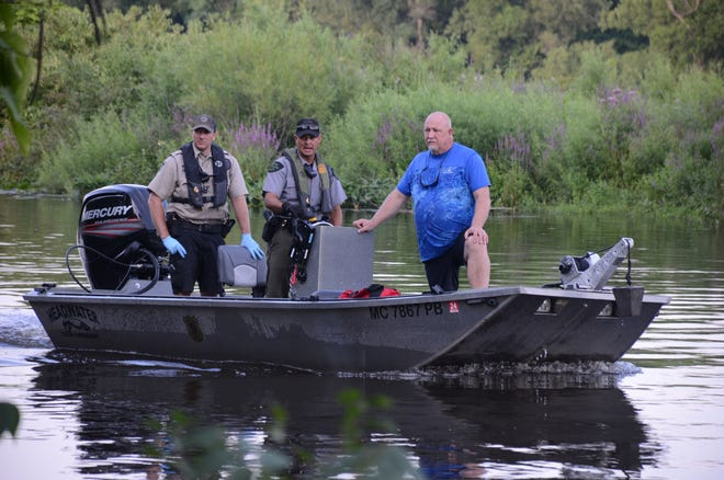First responders prepare to recover the body of a man from the Kalamazoo River in Battle Creek on Sunday.