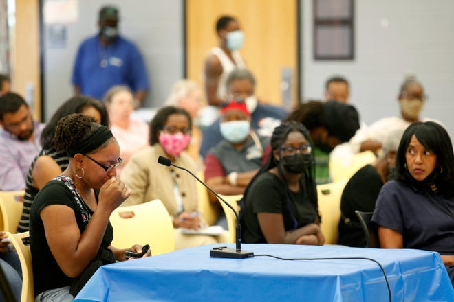 Aurelia Persley begins to cry as she talks about the fear she has for herself and her children due to gun violence in her community at a Monday, July 26, 2021, Cincinnati City Council neighborhoods committee special meeting at Roll Hill Elementary School in East Westwood.