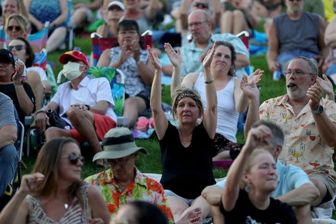 Fans listen to Chicago at the DTE Energy Music Theatre in Clarkston Sunday, July 25, 2021.