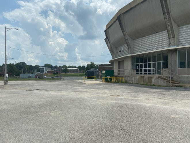 The north edge of Oman Arena is shown with construction work at Jackson Central-Merry High School across North Royal Street going on in the background.