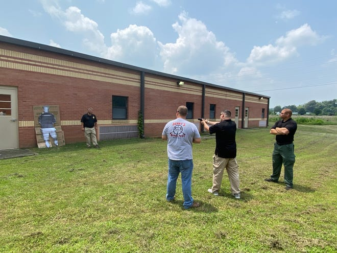 Officers train with the PhaZZer Enforcer weapon.