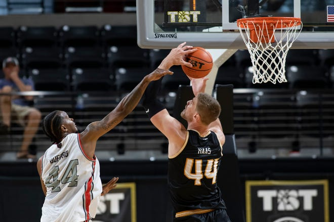 Carmen's Crew William Buford (44) blocks Men of Mackey's Isaac Haas (4)  during the second round of TBT against at the Covelli Center in Columbus, Ohio July 25. Carmen's Crew would go on to win the game 80-69.  Ceb Carmens Crew 0727 010