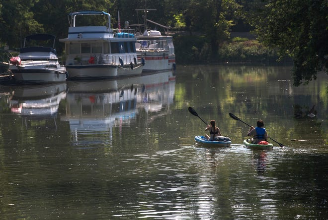 A couple made their way along Harrod's Creek after leaving Nachand's Canoe & Kayak, on River Road. July 26, 2021