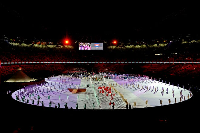 Jul 23, 2021; Tokyo, Japan; An overall view of the parade of athletes during the opening ceremony for the Tokyo 2020 Olympic Summer Games at Olympic Stadium. Mandatory Credit: Geoff Burke-USA TODAY Sports