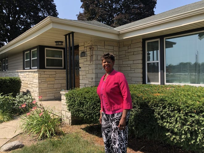 """Lora Hyler recently won an award for her essay """"The Bill of Rights, One College-Educated Negro Man, and a 1955 Protest by 39 White Wauwatosa Women."""" She's pictured here standing in front of the home that inspired the essay."""