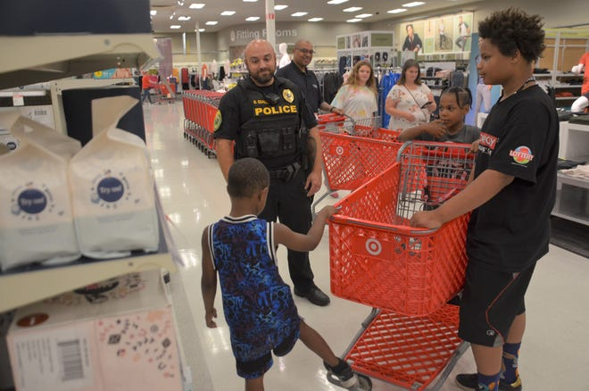 Local police officers on Saturday helped Muncie youngsters with back-to-school shopping at an event, hosted by Muncie Crime Stoppers, at the local Target store.