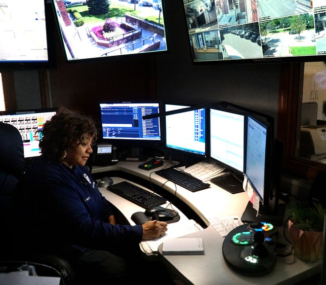 Birmingham Police Department employee Terez Willis is preparing to retire from dispatch work after 31 years on the job.  Here she monitors multiple computer screens at the department's Martin Street location.