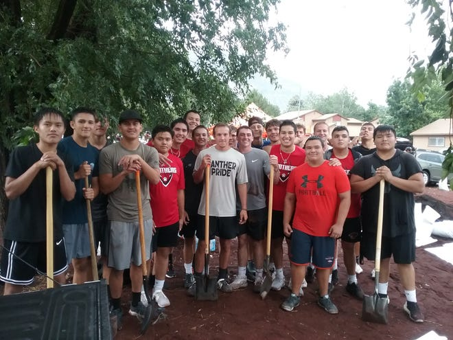 Coconino football players jumped into action to help Flagstaff community hit hard by the flood. Photo courtesy of Mike Lapsley
