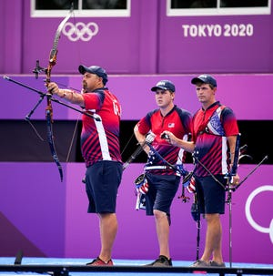 Jul 26, 2021; Tokyo, Japan; From left, Brady Ellison, Jack Williams, and Jacob Wukie (USA) compete in the men's team 1/8 eliminations during the Tokyo 2020 Olympic Summer Games at Yumenoshima Archery Field. Mandatory Credit: Andrew Nelles-USA TODAY Sports