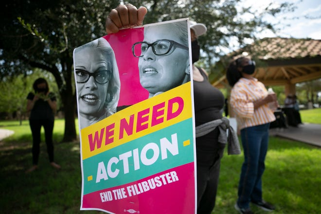 Protesters demand Sen. Kyrsten Sinema, D-Ariz., end the filibuster during a rally in Phoenix on July 26, 2021.