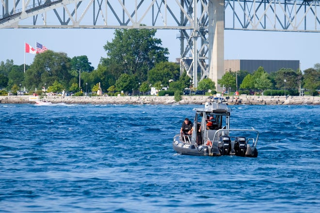 The St. Clair County Dive Team searches the St. Clair River Monday for a possibly missing person.