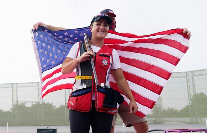 Amber English celebrates after winning gold in the women's skeet final at Asaka Shooting Range.