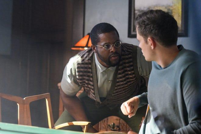 "Will (Winston Duke, left) tests Kane (Bill Skarsgard) to see if he's a soul ready to go to Earth in the sci-fi drama ""Nine Days."""