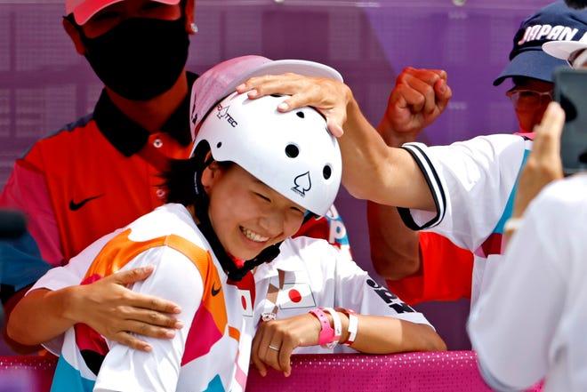 Momiji Nishiya (JPN) celebrates winning the gold medal in women's street skateboarding.