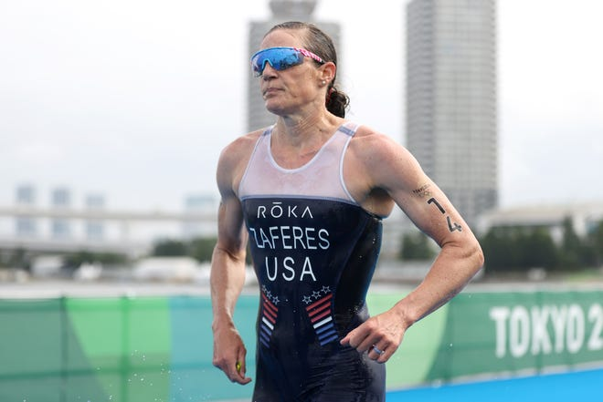 American Katie Zaferes runs to a bronze medal in the Olympic women's triathlon at Odaiba Marine Park.