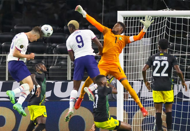 Matthew Hoppe (13) scores a goal past Jamaica goalkeeper Andre Blake (1) during the second half of the USMNT's Concacaf Gold Cup quarterfinal win against Jamaica.