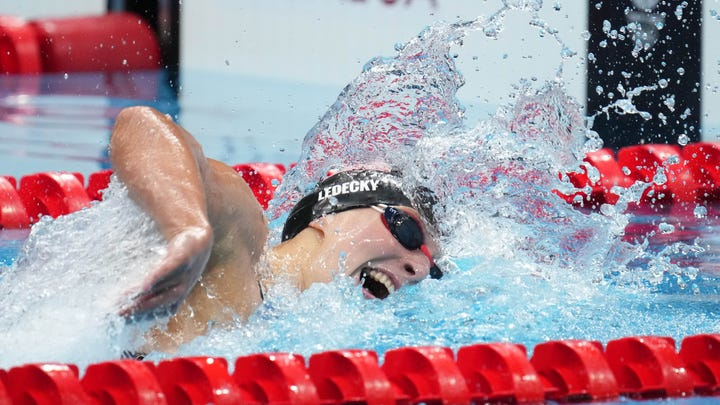 Katie Ledecky reaches for the wall in the women's 400m freestyle final at Tokyo Aquatics Centre. She finished second to Australia's Ariarne Titmus by .67 of a second.