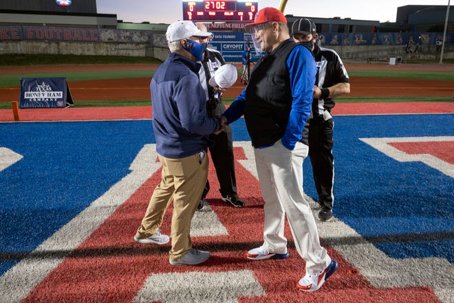 Westlake coach Todd Dodge, right, meets Hays coach Les Goad before the teams' district game last season. Dodge, who recently announced his impending retirement, will enter his final campaign with a 217-72 career record and six state championships, including two with Westlake in the past two years.