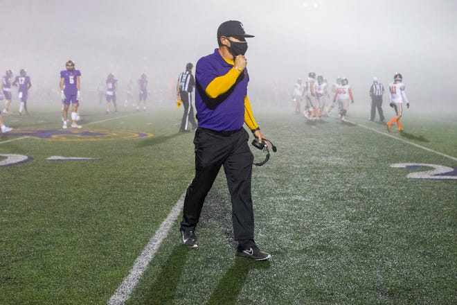 Liberty Hill coach Kent Walker calls out to his team during a foggy bidistrict playoff game against Glenn last season at Panther Stadium. Kent Walker took over the program last November after his brother, Jeff Walker, died following a battle with cancer.