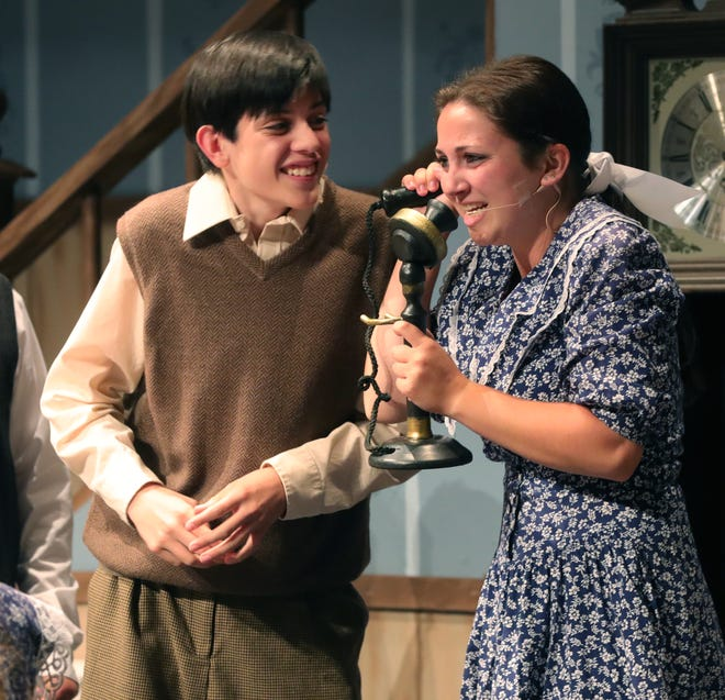 """Frank (Dante Navarrete) is teasing his older sister Anne (Laura McWilliams) about a boy calling the house to ask her out for a vanilla soda at the drugstore in a scene from Dynamics Community Theater's """"Cheaper by the Dozen,"""" which premiered on July 30."""