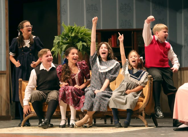 """The Gilbreth children in the Dynamics Community Theater's """"Cheaper By The Dozen"""" are excitedly voting together to buy a Collie puppy with the leftover money Dad taught them to save by running the household more efficiently."""