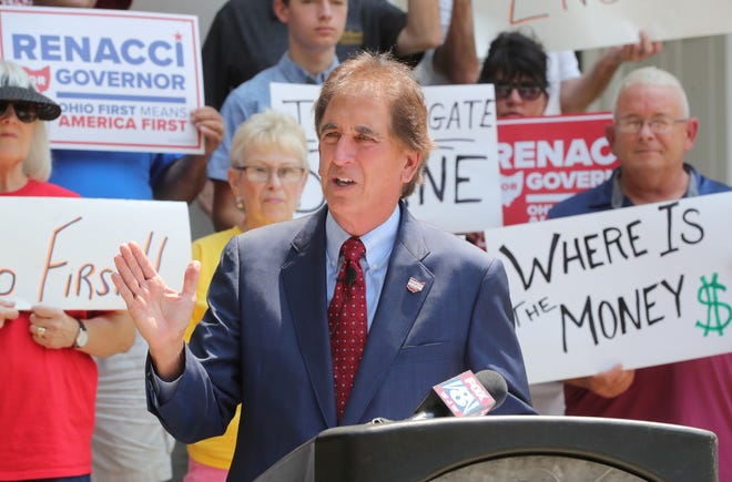 Republican gubernatorial candidate Jim Renacci stands on the Medina County Courthouse steps Tuesday during a news conference in which he called for an investigation of Gov. Mike DeWine's campaign contributions from FirstEnergy Corp.