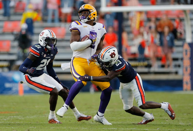 LSU tight end Arik Gilbert is tackled by Auburn defensive back Roger McCreary during their game last season at Jordan-Hare Stadium. Gilbert has transferred to Georgia, where Bulldogs teammates hope the 6-foot-5, 248-pound tight end can make a big impact.