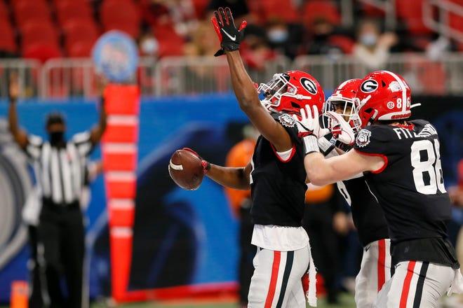 Georgia wide receiver George Pickens celebrates his touchdown catch in the first quarter of the Chick-fil-A Peach Bowl against Cincinnati last season.