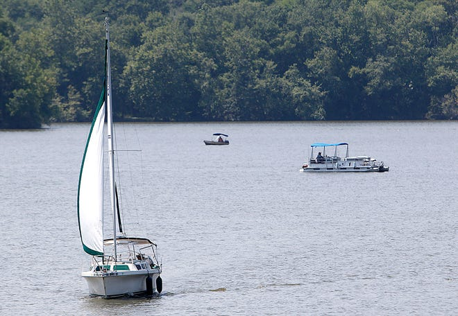It was a nice day Monday, July 26, 2021 to be out on Charles Mill Lake as evident by this sailboat, pontoon boat and fishing boat seen out on the lake. TOM E. PUSKAR/TIMES-GAZETTE.COM